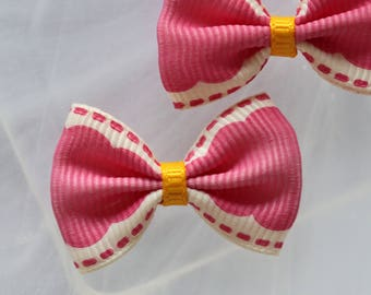 Pretty pink dotted ribbon bow