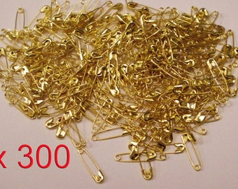 Set of 300 Mini pins of nurses in Metal Golden 19 x 5 mm.
