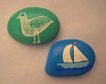Bird and Sailboat Painted Rocks