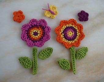 my flower garden handmade crocheted 2 large flowers, 2 small flowers, 1 butterfly, stems and feulles(11 pièces)