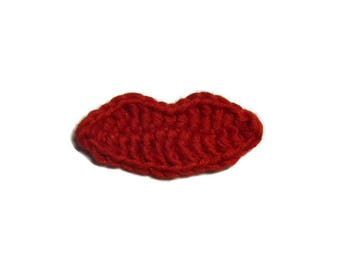 Red lips are hand crocheted