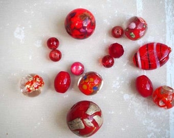 Set of 15 different styles, oval, round, flat red tones glass beads