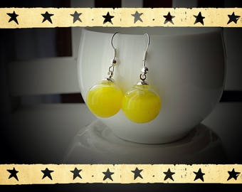 Opaque yellow color liquid filled glass globe mounted on Stud Earrings