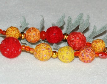 Keychain or accessory bag in red/orange hand felted beads