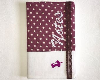 Purple notebook white stars with elastic for support and embroidered fabric cover