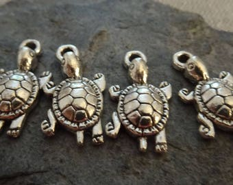 """4 """"turtle"""" charms in antique silver.   Size: 22mm x 12mm. Hole: 2mm (the electric cables)."""