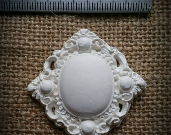 Finely crafted in raw cast Medallion