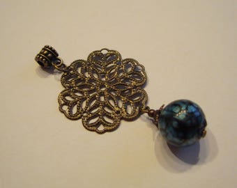 Mounted pendant. Print and speckled glass bead