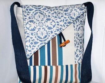 Handbag satchel blue/brown/beige/off white upholstery fabric.
