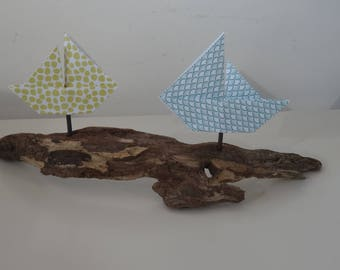 Decorative boat origami on Driftwood in shades of blue-green