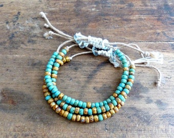 Trio of turquoise and ocher sliding bracelets