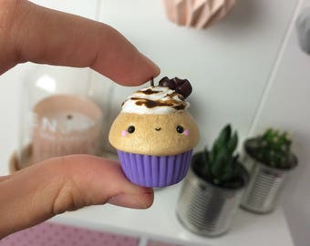 Cupcake with a purple base and a chocolate sauce, polymer clay pendant.