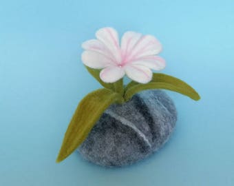 Felted flower on a stone