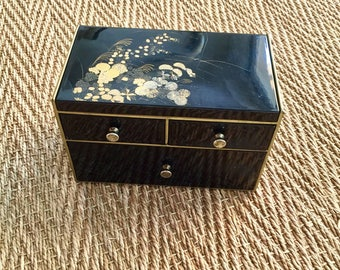 Black and gold jewelry box with mirror