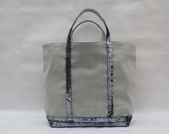 The light gray with sequins creating Aandm mouse gray tricky linen carrier