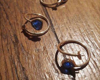 The golden ring with spade to customize and Blue Crystal