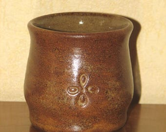 Small brown glazed stoneware mug