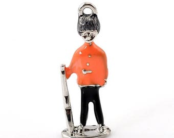 x 1 English silver-plated enameled orange and black character charm.