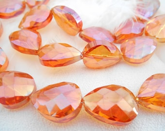 A set of 6 glass Teardrop beads faceted orange AB.
