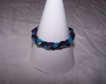 Bracelet with silver nuts, black, blue and purple tones and jersey