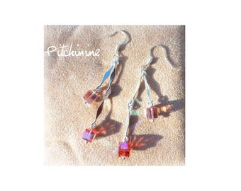 primers and original crystals for these earrings adorned with pink crystals
