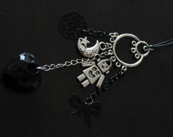 Collar type necklace with several charms