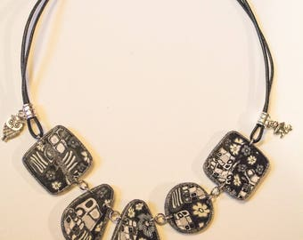 Vintage mosaic black and white reversible polymer clay necklace.