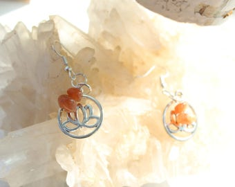 Sunstone earrings symbolizes: life force and the lotus flower