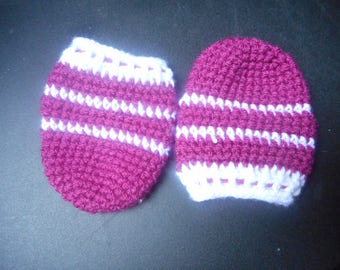 Pink and white baby mittens