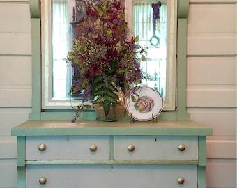 Three-drawer dresser with large mirror