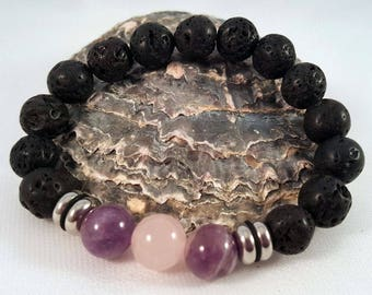 Gemstone bracelet made of lava, amethyst and rose quartz as well as stainless steel elements