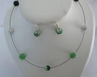 Set in Rhinestones, necklace and earrings in shades of green