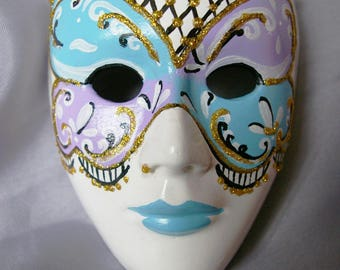 blue white Venetian style mask plaster purple and sky