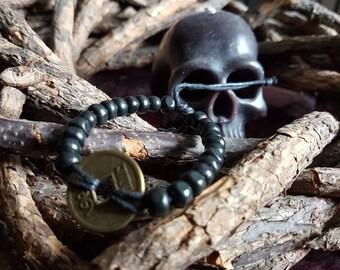 Black bracelet with wooden beads and einerMünze