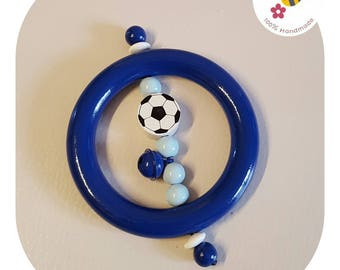 Julius the rattle with soccer ball