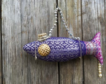 Decorative fabric fish embellished with jewels.