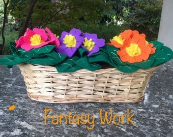 Wicker basket with three bouquets of Primroses of felt