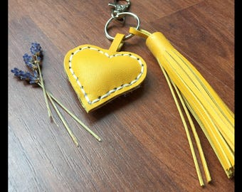 Leather key ring yellow with heart and tassel