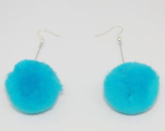 Large blue pompom earrings in silver