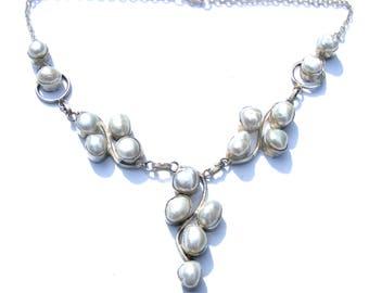 Collier argent 925 et perles d'eaux douces naturelles blanches avec chaine argenté.