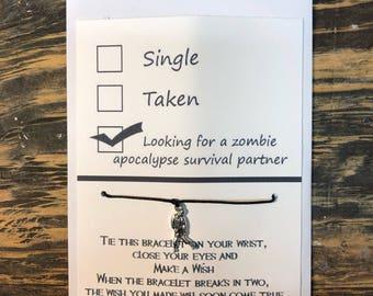 Zombie wish bracelet.Zombie charm bracelet. Looking for a zombie apocalypse survival partner.