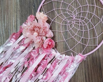 Beautiful handmade pink flower web dreamcatcher hangs 23 inches in length and 8 inches in width.