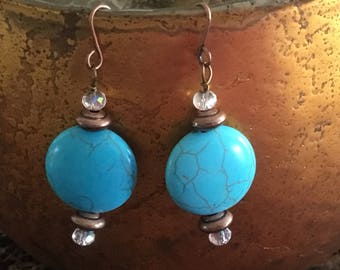 Blue turquoise colored stone earrings with copper accents