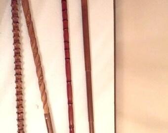Set of 4 vintage walking sticks/ handcarved