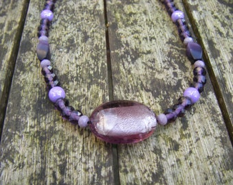 Purple beaded necklace with Lampwork pendant