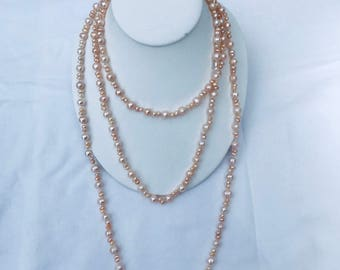 Fresh water pearl necklace .
