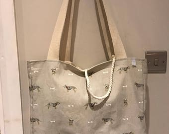Shoulder bag with border terrier material.