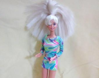 Vintage 1966 Mattel Barbie in her party dress.