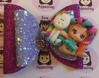 Pink and lilac glitter bow with girl and unicorn clay figure  ideal for girls, party hair, dress up hair