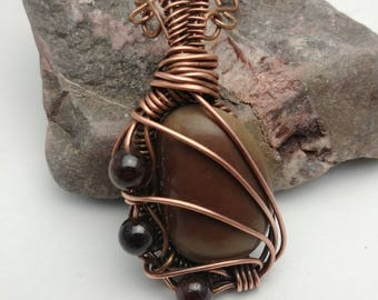 Copper Wire-wrapped Stone Pendant with Garnet Bead Accents